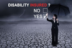 Businesswoman with text of disability insured Stock Images