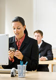 Businesswoman text messaging on cell phone Royalty Free Stock Photo
