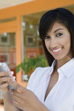 Businesswoman Text Messaging On Cell Phone Royalty Free Stock Photography