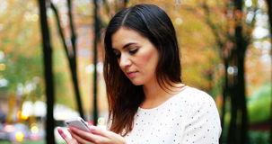 Businesswoman text messaging on mobile phone. While travelling stock video footage