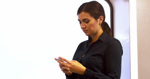 Businesswoman text messaging on mobile phone. While walking at street stock footage