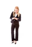 Businesswoman text messaging on a mobile phone Stock Image