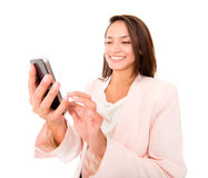 Businesswoman texting on her phone Royalty Free Stock Photos