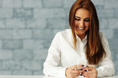 Businesswoman texting on her smartphone Royalty Free Stock Photo