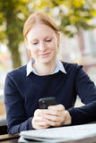 Businesswoman Texting During Lunch Break Royalty Free Stock Image