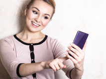 Businesswoman texting reading sms on smartphone Stock Photo