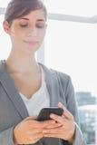 Businesswoman texting on smartphone Stock Photo