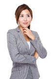 Businesswoman think and look away Royalty Free Stock Images