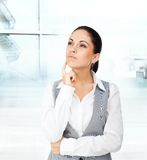 Businesswoman think looking up copy space. Businesswoman think looking up empty copy space, young business woman think, idea, hand finger on chin pondering stock photo