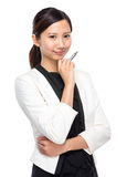 Businesswoman think with pen Royalty Free Stock Photography