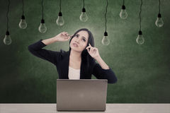 Businesswoman think under light bulbs Stock Photo