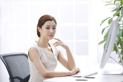 Businesswoman is thinking Royalty Free Stock Photo