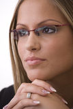 Businesswoman thinking. Portrait of young attractive businesswoman wearing glasses, thinking Royalty Free Stock Images