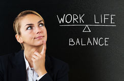 Businesswoman Thinking About Balancing Work Life. Young Businesswoman Thinking About Balancing Work Life On Black Background Royalty Free Stock Photo
