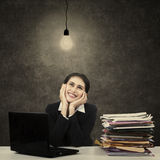 Businesswoman thinking bright solution. Portrait of businesswoman thinking bright solution at office Stock Photos