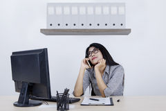 Businesswoman thinking with cellphone Stock Image