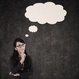 Businesswoman thinking and cloud copyspace Stock Images