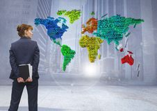 Businesswoman thinking with Colorful Map with city background Royalty Free Stock Image