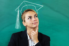 Businesswoman Thinking Of Completing Education. Young Businesswoman Thinking Of Completing Education At Business School Stock Photography
