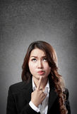 Businesswoman with thinking face Stock Photo