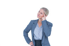 Businesswoman thinking with finger on head Stock Image