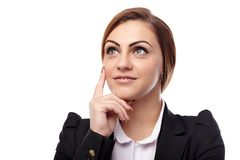 Businesswoman thinking with hand on chin Royalty Free Stock Image