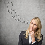 Businesswoman thinking. About the idea, close up Royalty Free Stock Image