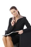 Businesswoman thinking looking at organizer Royalty Free Stock Images