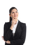 Businesswoman thinking and looking sideways isolated Stock Images