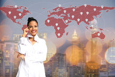 Businesswoman thinking on the map world,. Global communication and check in, city background Royalty Free Stock Image