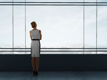 Businesswoman thinking. In office and looking to window Royalty Free Stock Photo