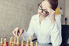 Businesswoman thinking during playing chess Royalty Free Stock Photo
