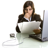 Businesswoman thinking with reports in the hand Royalty Free Stock Photos