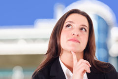 Businesswoman thinking something Stock Photo
