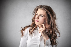 Businesswoman thinking of something Stock Photography