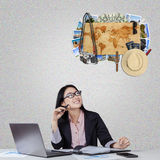 Businesswoman thinking about traveling Stock Images