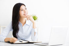 Businesswoman thinking while working on computer Stock Photos