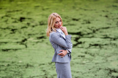 Businesswoman thinks against the swamp Stock Images