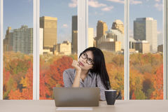 Businesswoman thinks an idea in the office Royalty Free Stock Photo
