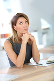 Businesswoman with thoughtful look Stock Photography