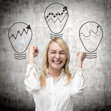Businesswoman and three lamp Stock Photo