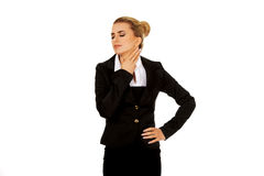 Businesswoman with throat pain. Businesswoman with terrible throat pain Royalty Free Stock Image