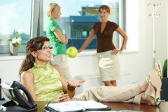 Businesswoman throwing apple Royalty Free Stock Photography
