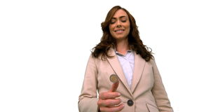 Businesswoman throwing a coin in the air on white screen in slow motion stock video