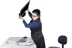 Businesswoman throwing computer Royalty Free Stock Images