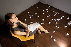 Businesswoman throwing crumpled paper on floor Royalty Free Stock Photos