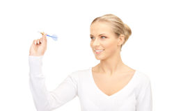 Businesswoman throwing a dart Stock Photography