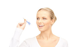 Businesswoman throwing a dart Stock Images