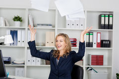 Businesswoman Throwing Documents In Office Stock Photo