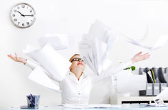 Businesswoman throwing files. Royalty Free Stock Images